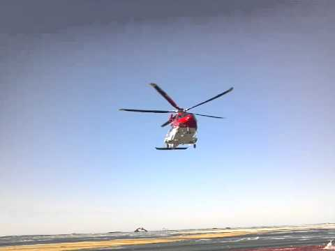 Era rescue chopper coming in for a landing offshore.