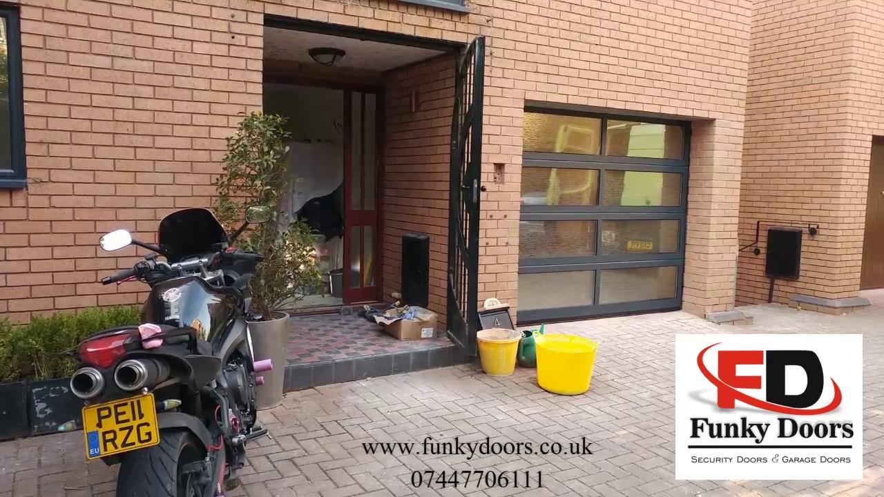 Glazed Sectional Garage Door/ Full view Aluminium garage door. Funky Doors & Glazed Sectional Garage Door/ Full view Aluminium garage door ...