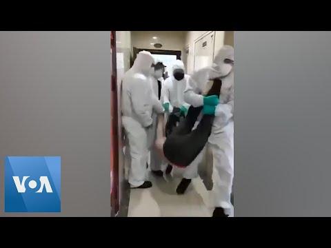 Chinese Police Force Family Into Coronavirus Quarantine