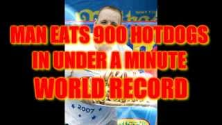 Repeat youtube video MAN EATS 900 HOT DOGS IN UNDER A MINUTE! WORLD RECORD!
