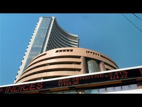 Sensexclimbs 200 points,Rupee up 10 paise against dollar