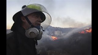 Israel battles the biggest Wild fire in its history - Um, um, um