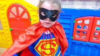 Eva loves to dress up as superheroes and play with mom