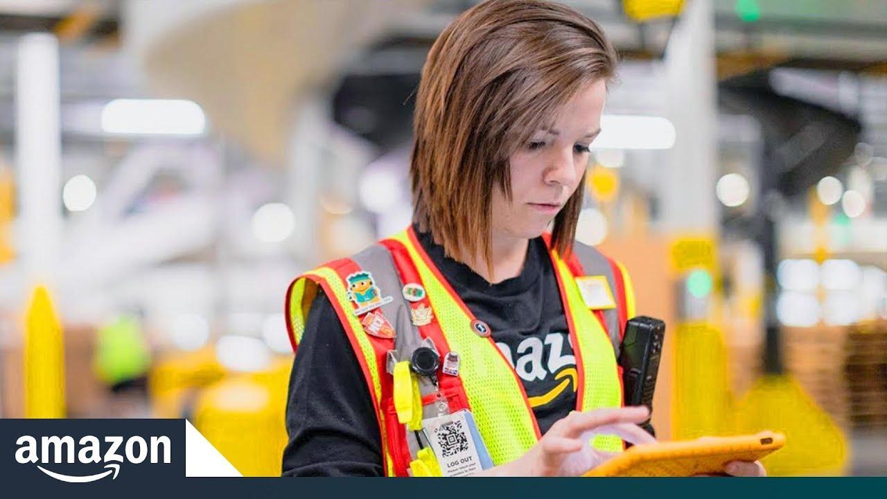Cathryn Kachura works alongside Amazon's newest robots
