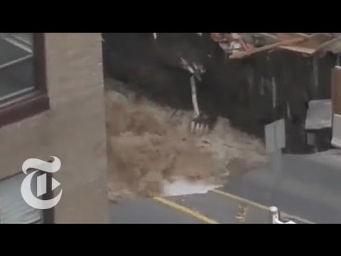 Giant Sinkhole Swallows Car, Road in Ottawa   The New York Times