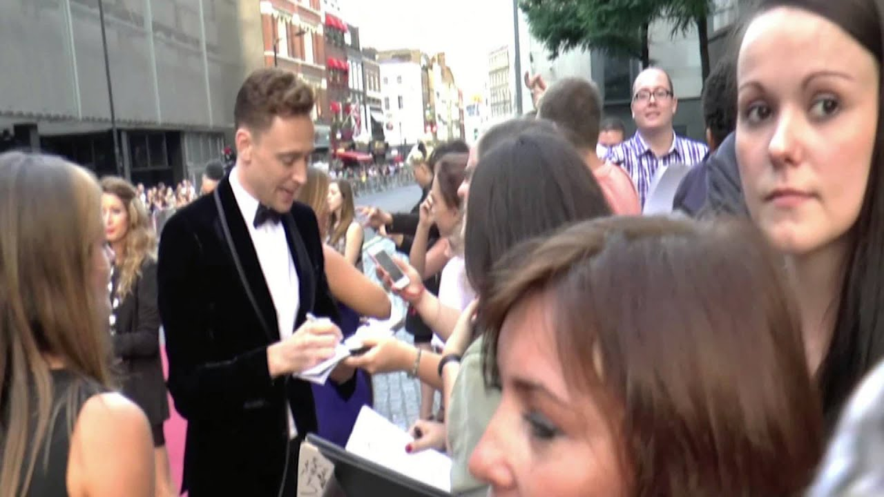 Tom Hiddleston the GQ Men of the Year Awards 2013 red carpet arrival.