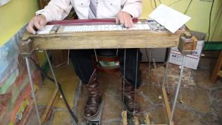 demonstrating a home made pedal steel guitar