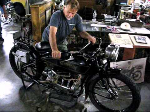 Dale Walksler starting the 1917 Henderson motorcycle At Wheels Through Time Museum