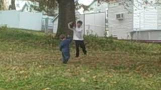 2 year  old playing football with a ten year old