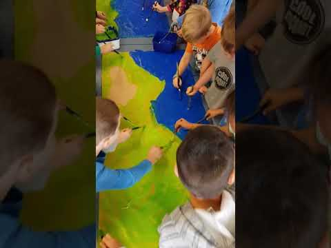 Collaborative painting and singing. Happy campers.
