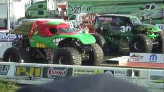 Grave Digger vs. Teenage Mutant Ninja Turtle Drag Race at the Rocky...