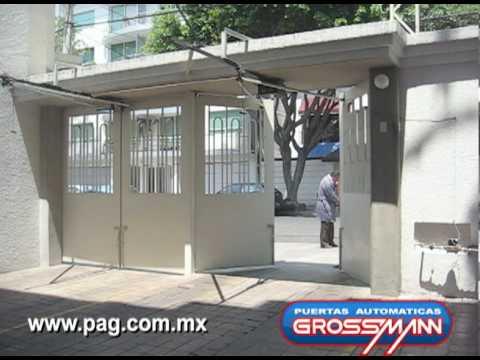 Puerta automatica abatible hacia afuera con marquesina - Puertas de cocheras ...