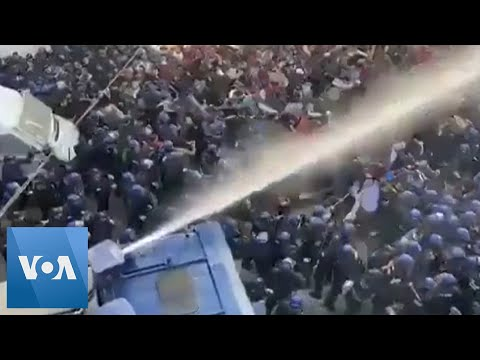 Police Use Water Cannon To Disperse Protesters In Algeria