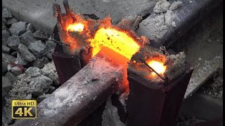 Rails thermite welding - Eruptions, melt squeezing and grinding [4K]