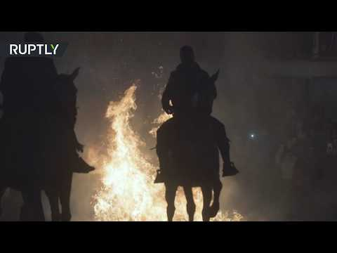Horses 'purified' by fire as part of 500yo tradition in Spain