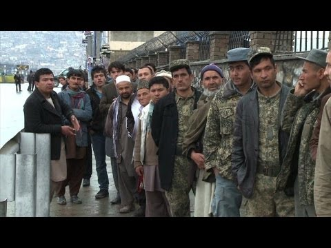 Afghan election frontrunner vows reconciliation with Karzai