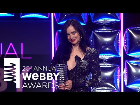 Mike Colter presents to Krysten Ritter at The 20th Annual Webby Awards