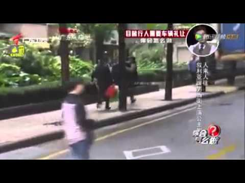 Two Muslim Arab Syrian guys help an old man walking the street in China
