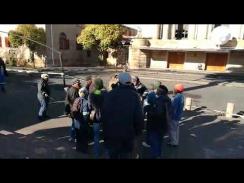 A few municipal workers singing struggle songs outside the Bloemfontein City Hall