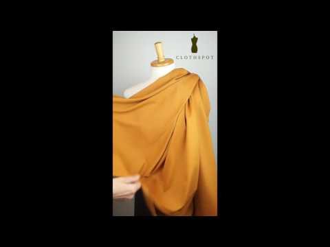 Draping ochre ponte Roma jersey fabric