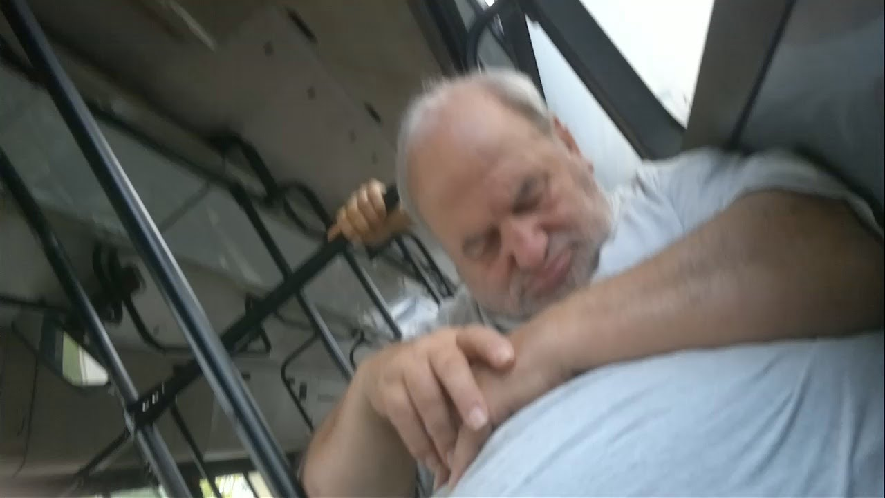Fat man sleeping on bus