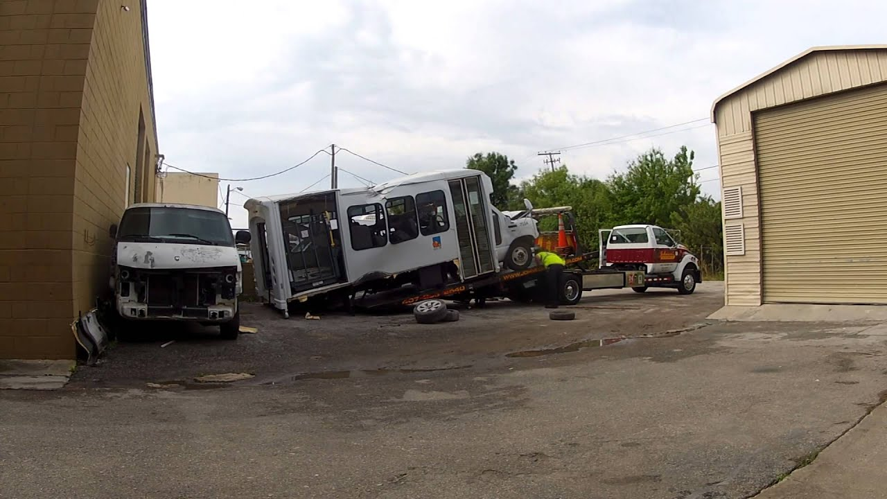 Loading the Junk MV Transportation bus onto a Tow Truck - YouTube