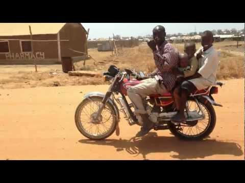 Efficient Traveling -- 4 Smiling People on 1 Motorcycle in Juba, South Sudan