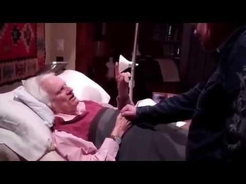 Dr Billy Graham prays for a Pastor