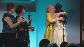 An unlikely pair: Hillary Clinton surprises Katy Perry at UNICEF Ball