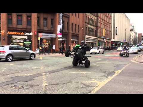 Quad Bike Wheelie in Manchester City Centre