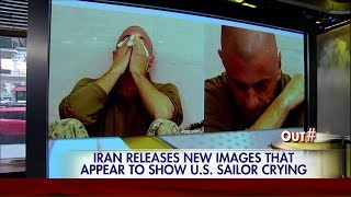 Iran releases image of U.S. sailor crying.