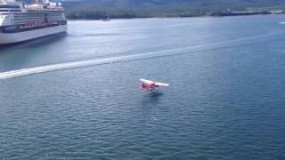 Red and White SeaPlane Landing in the Water Flying Friday #50 thumbnail