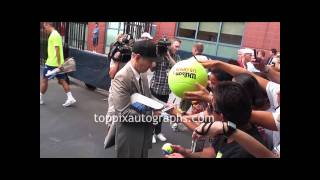 John McEnroe - Signing Autographs at the 2011 U.S. Open in Flushing Meadows