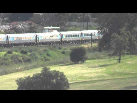The morning XPT crosses the Moonee Ponds creek bridge headed for Sydney. Australian Trains.