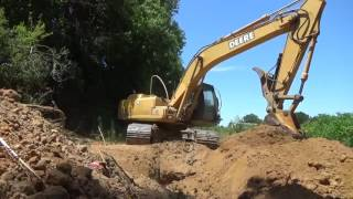 John Deere 200 excavator digging part 2