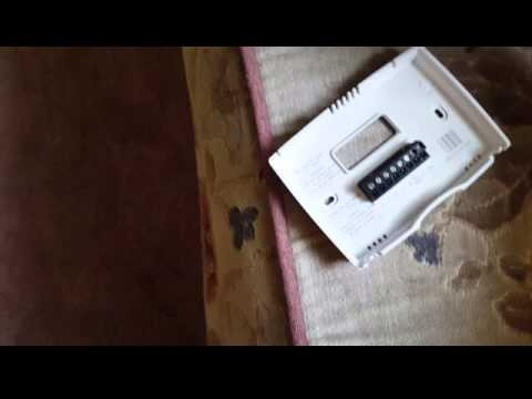 Remove cover from Honeywell thermostat - YouTube