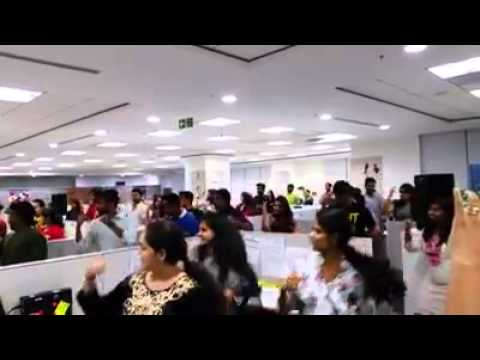 Multinational company staffs dancing in office