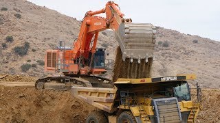 Hitachi EX1200 Excavtor loading Cat 777 Trucks