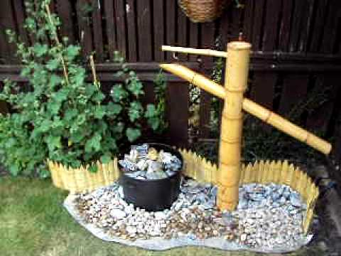 Japanese water fountain shishi odishi youtube for Japanese bamboo water feature