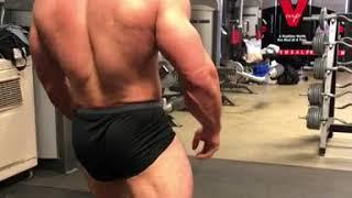 Luke Carroll gym posing