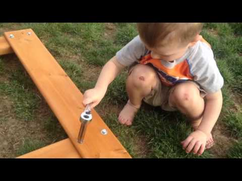Remy helps build his swingset