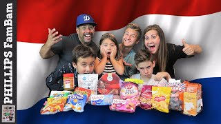 DUTCH FOOD TASTE TEST | AMERICANS TRY CANDY SNACKS FROM THE NETHERLANDS | PHILLIPS FamBam Taste Test