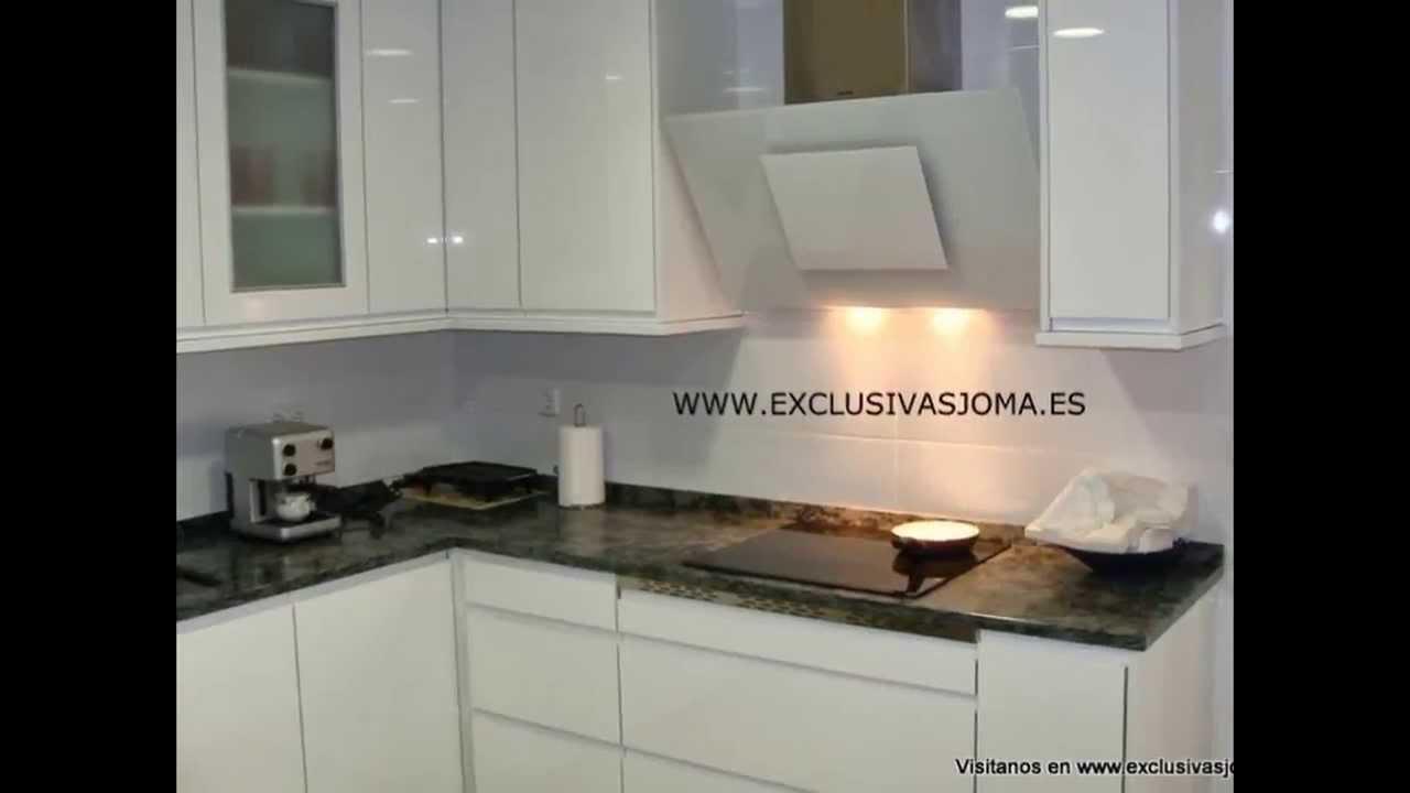 Muebles de cocina en blanco alto brillo con tirador uero