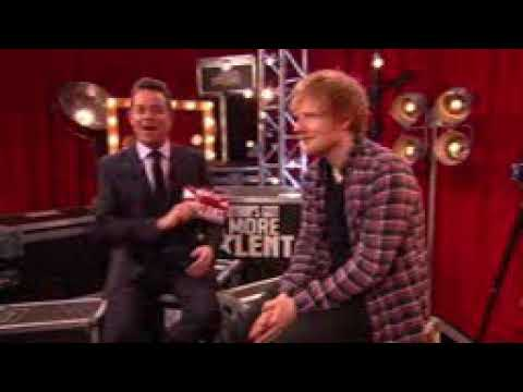 Ed sheeran squeezing chocolate in his mouth.
