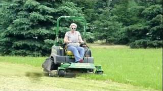 Susy operates the JD 997 John Deere Zero Turn Mower like a professional