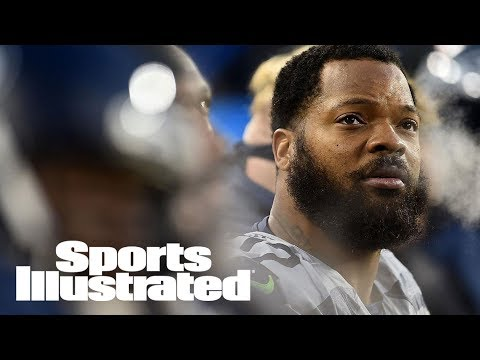 Seattle Seahawks' Michael Bennett Sits During National Anthem | SI Wire | Sports Illustrated