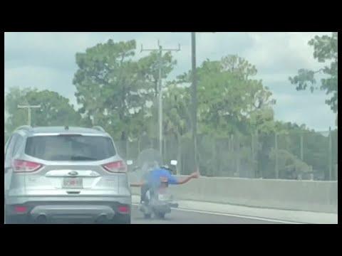 Deuce - Motorcyclist Performs Stupid Stunt On I-4