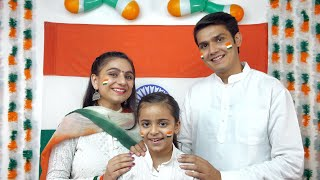 Young Indian family happily posing for the camera on the occasion of Independence day / Republic day