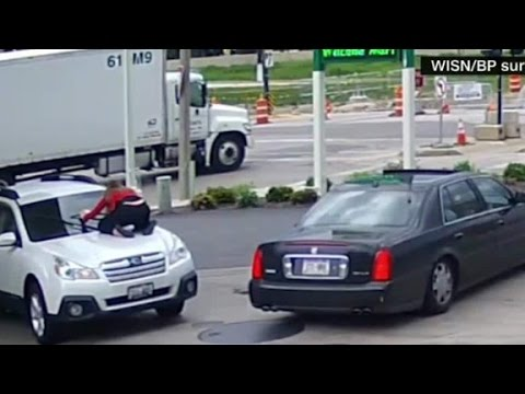 Thumbnail: Woman jumps on hood of car to stop thief