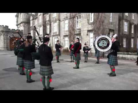 Ballater Pipe Band parade in front of Balmoral Castle in Royal Deeside, Scotland, April 2018